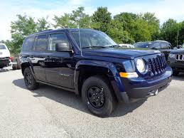 dark green jeep patriot 2016 jeep patriot true blue edition with 16 x 6 5 inch tires