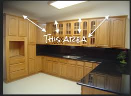 what to do with space above kitchen cabinets how to cover space above cabinets