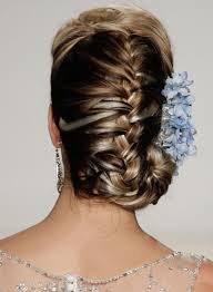 hair in a bun for women over 50 50 indian hairstyles for round faces