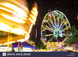 carrousel or merry go and ferris wheel at cornyval fair in