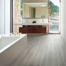 grey tile flooring that looks like wood tile flooring that looks