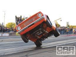 monster trucks drag racing world power wheelstand championships wild wheelie contest action
