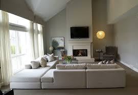 traditional living room with pendant light u0026 stone fireplace in