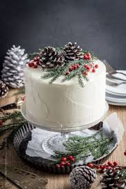 cute christmas cake with tiny gingerbread house dekoracje