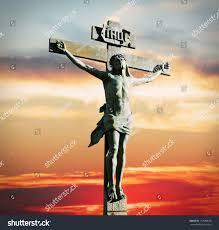 crucifixion jesus christ on sunset sky stock photo 117589636