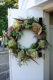 door wreath with hydrangea and pheasant feathers from bella rosa