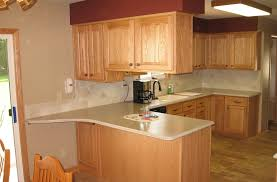 do you tile under kitchen cabinets kongfans com