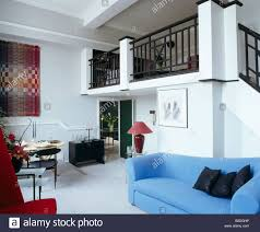 modern blue sofa in open plan living and dining room with
