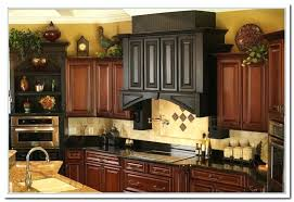 ideas for tops of kitchen cabinets the cabinet decor ideas ideas above kitchen cabinets 2