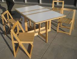 simple brown nuance folding outdoor tables and chairs in wood
