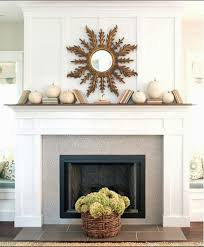 showing off kathleen white fireplace penny tile and mantle