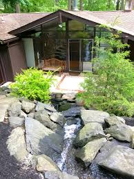 midcentury modern in newtown square has its own waterfall asks