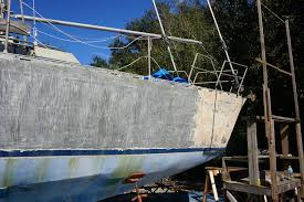 going bare stripping the paint off our aluminum hull matt
