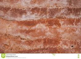 shades of orange rammed earth wall with different shades of orange soil stock photo
