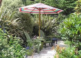 patio umbrella stand side table how to make a flowering outdoor umbrella stand apartment therapy