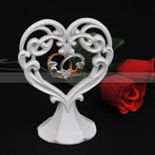 ring cake topper ivory porcelain heart shaped wedding cake topper with rings