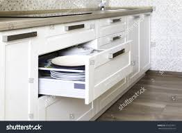 opened kitchen drawer plates inside smart stock photo 576257071