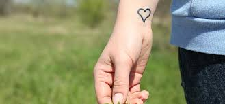 real heart tattoos on wrist pictures to pin on pinterest tattooskid