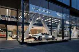 aston martin dealership aston martin unveils new auckland showroom and delivers vantage