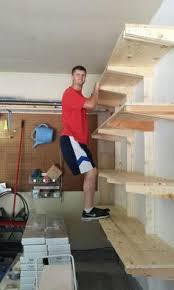 Building Wooden Shelves In Garage by Garage Shelves Using 2x4s Plywood And Wrought Iron Brackets And