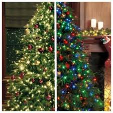 white pre lit christmas tree with colored lights white lights or multi color on your tree the dilemma is solved