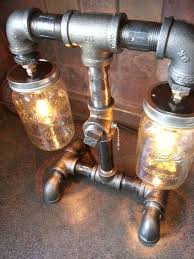 diy mason jar light with iron pipe steampunk style black iron pipe l mason jar bar by flamemetals
