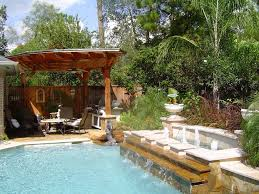 Lounge Chairs For The Pool Design Ideas Exterior Overflowing Backyard Pool And Spa For Luxury Backyard