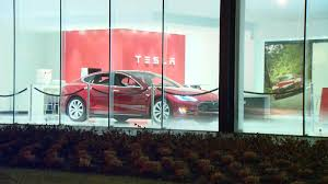 tesla delivers first 30 model 3 cars but long wait remains for