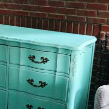 Light Turquoise Paint by Before And After Distressed White Dresser To A Bright Turquoise