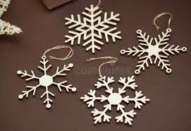 laser cut wood snowflakes ornaments wooden snowflakes on brown