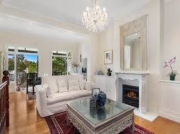 very elegant living room with white fireplace ornate mirror and