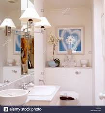 Painted Bathroom by Lamps On Mirror In White Painted Bathroom With Buddha Statue And