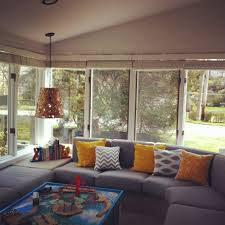 Modern Sunroom Inspiring Grey Sectional In Modern Sunroom Living Area With Floor