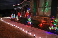 outdoor christmas lights for bushes start with path lights work your way from the ground up