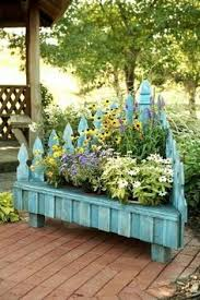 Upside Down Bench An Old Wire Flower Edging Fence Turned Upside Down Hung From The