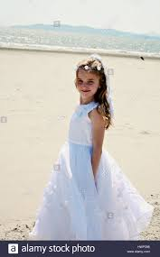 where to buy communion dresses girl in holy communion dress on the stock photo
