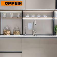 european style modern high gloss kitchen cabinets oppein modern european style high gloss grey kitchen cabinets