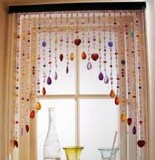 house window with colorful hanging beaded curtains beaded