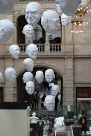 the famous hanging heads art installation picture of kelvingrove