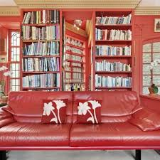 Red Floral Sofa by Apartments Cozy Living Room With Wood Dining Furniture And White