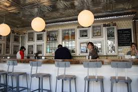 Ceiling Tile Light Fixtures Contrast With Tin Ceiling And Modern Light Fixtures And Bar