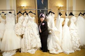 wedding dress designer jakarta designer yumi katsura poses with 2012 wedding dresses