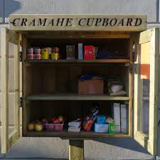 wall of shelves community comes together to launch cramahe cupboard in colborne