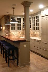 best kitchen bar counter ideas only pinterest like the wood bar top and colour cabinets also floor that hardwood small basement kitchenbasement