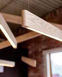 wood beam light fixture wood beam wood beam light line lights in white ash repost matthew