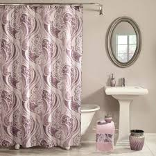 interesting shower corner bathroom decorated with oval mirror and artistic deep purple shower curtain design with curved stainless steel metal rod covering shower