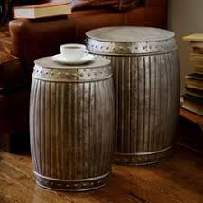 silver barrel side table crafted by hand from celadon ceramic the figurine depicts the wise