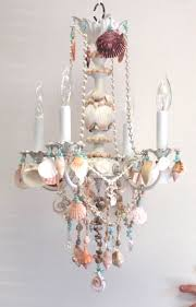 crystal and shell chandelier embellished witih seashells beach