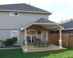 Covered Deck Ideas Trex Deck With Hip Roof And Grill Bump Out Amazing Decks