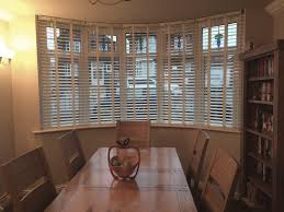 white wooden blinds for emma u0027s dining room bay window web blinds